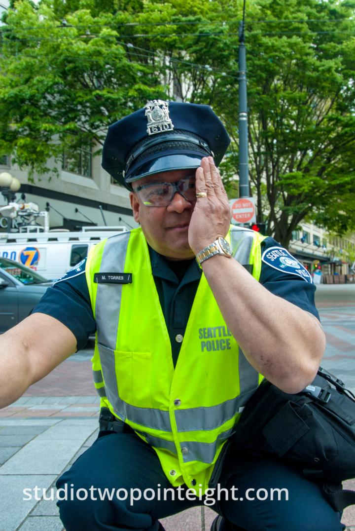 2015 Seattle May Day Protest, Seattle Police Officer Torres Squatted At Westlake Park
