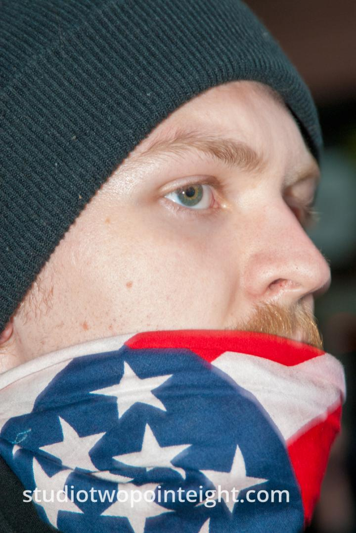 2015 Seattle May Day Protest Riot, Near Dusk A Protester's Stars and Stripes Bandanna Came Loose