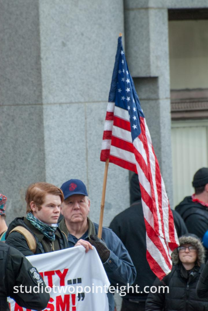 seattle rally counterprotesting socialists displaying american flag