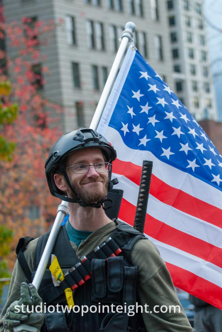 Seattle, Liberty or Death 2 Rally, December 1, 2018, Washington Three Percent Member Carrying A Stars and Stripes American Flag
