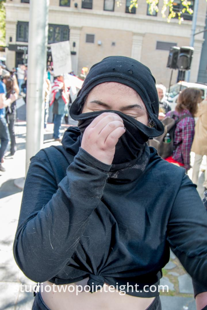 Seattle May 1, 2019 May Day Immigration Rally Female Marxist Antifa Black Bloc Terrorist Adjusts Disguise