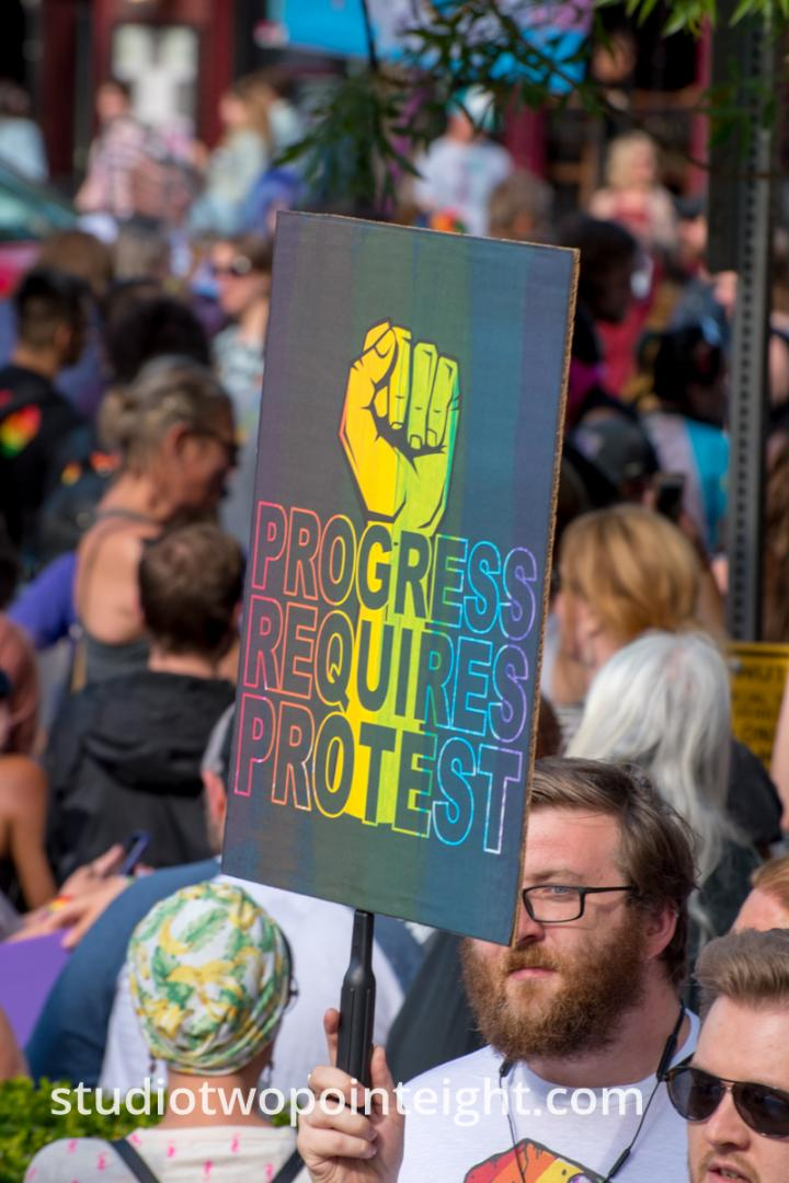 Seattle Trans Pride 2019, Man With Poster Progress Requires Protest