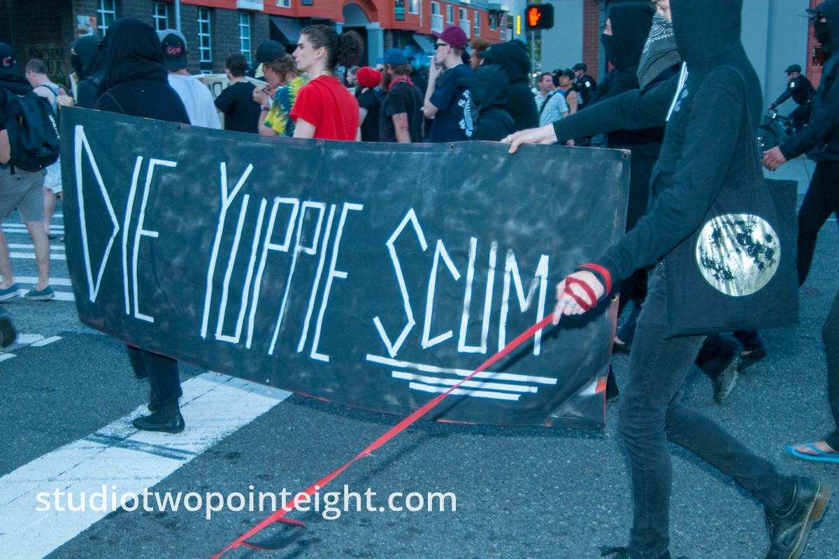2014 Seattle May Day Protest, Masked Anarchist Black Bloc Protesters With Die Yuppie Scum Banner