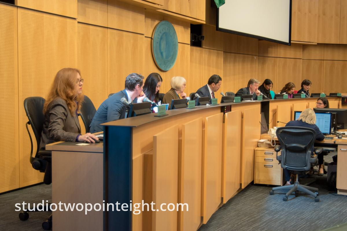 "This is the Seattle City Council from March 18, 2019 as it began its full council meeting at 2:PM that afternoon. The council chamber was packed to capacity by Seattle residents. During the meeting that day, the council voted on and unanimously passed its ""Mandatory Housing Affordability"" (MHA) ordinance. The MHA ordinance includes rules that govern the manner in which housing developers may development land in various areas around Seattle."