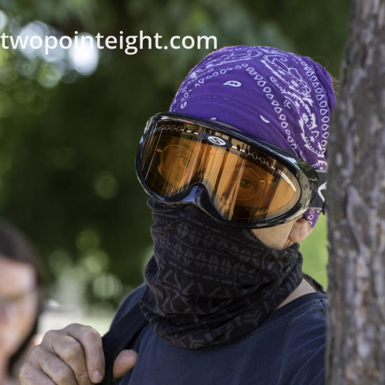 Studio 2.8, During Seattle Liberty March, A Masked and Goggled Anarcho-Communist Counter-Protester Posted For A Telephoto Lens Portrait