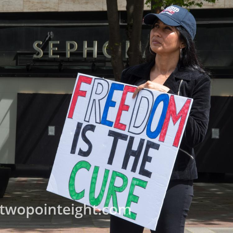 Studio 2.8, May 1, 2020, Seattle May Day End Coronavirus Lockdown Protest, Woman Displays Freedom Is The Cure Poster