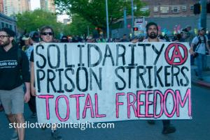 2014 Seattle May Day Protest, Anarchist Protesters Carried A Solidarity With Prison Strikers Banner