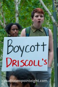 2015 Seattle May Day Immigrant Rally, Woman Holding Boycott Driscoll's Poster