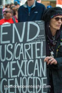 2015 Seattle May Day Immigrant Rally, Woman Holding End Cartel Sign