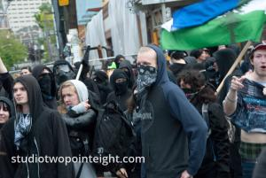2015 Seattle May Day Protest Mayhem, A Crowd Of Antifa Anarchist Black Bloc Protesters Jeered At Police