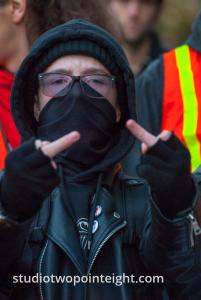 Seattle, Liberty or Death 2 Rally, December 1, 2018, A Masked Black Bloc Counter Protester Flipped The Bird