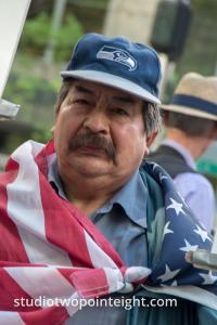 Seattle May 1, 2019 May Day Immigration Rally Attendee Wrapped in an American Flag