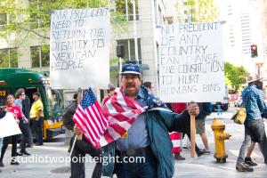 Seattle May 1, 2019 May Day Immigration Rally A Man Displayed Posters About Mexican Immigrants