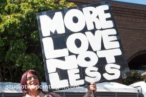 Seattle Trans Pride 2019, An Attendee With A More Love Not Less Sign