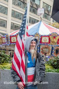 Studio 2.8 at Seattle Pearl Harbor Day Commemoration December 7, 2019, Attendee Carrying An American Flag