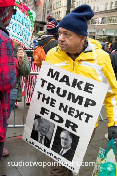 Studio 2.8, December 7, 2019, Pearl Harbor Day, McGraw Square Seattle, Man With Make Trump The Next FDR Placard
