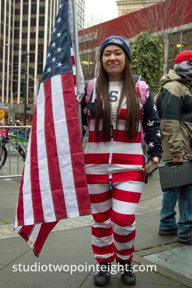 Studio 2.8, December 7, 2019, Pearl Harbor Day, McGraw Square Seattle, A Woman Wearing Festive Red, White, and Blue