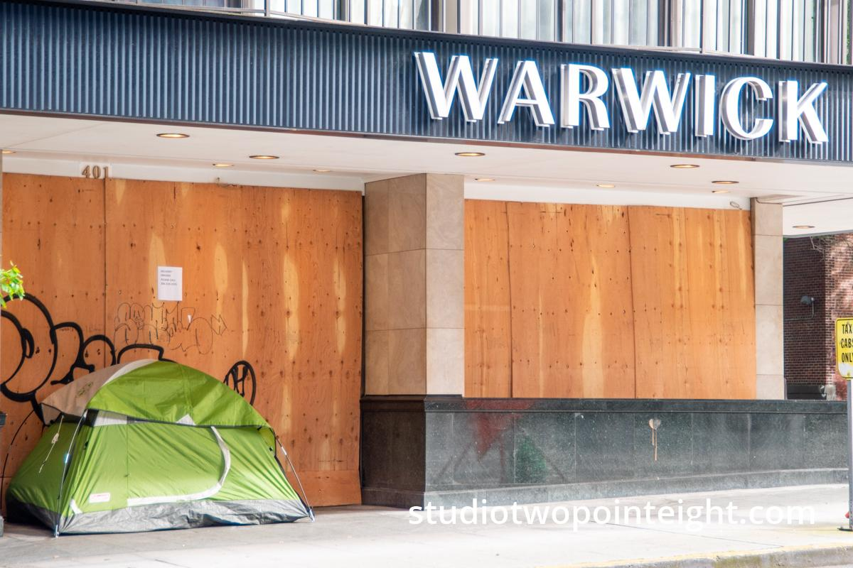 Studio 2.8 Documenting The 2020 Corona Virus Pandemic, Homeless Person Tent Camping Outside Closed, Boarded Up, Warwick Hotel